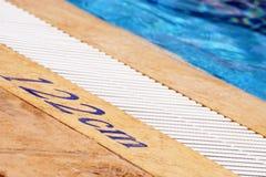 Swimming pool depth sign Stock Photos