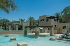 Swimming pool at the desert arabian resort Stock Photo