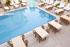 Swimming pool and dining area Royalty Free Stock Images