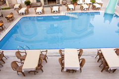 Swimming pool and dining area Stock Photo