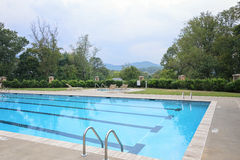 Swimming Pool with distant mountain views Royalty Free Stock Image
