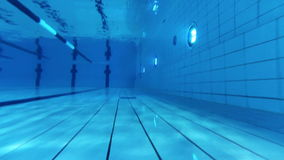 Swimming pool. Diving through the water. Swimming pool stock video footage