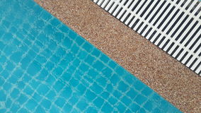 Swimming pool drainer. The gutter beside water pool to drain overflow Stock Image