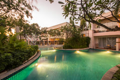 Swimming pool at dusk. In a nice relaxing resort Royalty Free Stock Photography