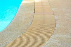 Swimming pool edge with drain Royalty Free Stock Photo