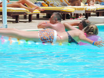 Swimming Pool. Egypt, Nov. 23 2014 : Happy people and girls in bikini enjoying bath time in pool, Sharm el-Sheikh Royalty Free Stock Photos