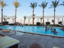 Swimming Pool. Egypt, Nov. 23 2014 : Happy people and girls in bikini enjoying bath time in pool, Sharm el-Sheikh Royalty Free Stock Photography