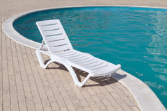 Swimming pool and empty resting chair Stock Photo