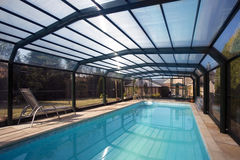 Swimming Pool Enclosure. A pool enclosure over a swimming pool in the garden of a house in Yorkshire in England Royalty Free Stock Photo