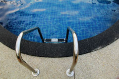 Swimming Pool. Entrance ladder to clean water Royalty Free Stock Photography