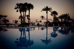 Swimming pool at evening Stock Photos