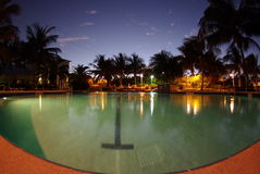 Swimming pool in the evening. A swimming pool in the evening under the blue sky stock images