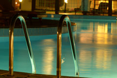Swimming pool in the evening. Outdoor Swimming pool with Ladder. Horizontal shot Royalty Free Stock Images