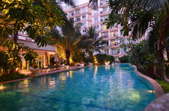 Swimming pool in evening, Pattaya, Thailand Stock Photo