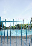 Swimming pool fence Royalty Free Stock Image