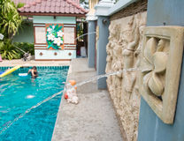 Swimming pool  with fountain. Swimming pool in backyard with fountain Royalty Free Stock Images