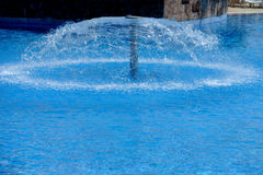 Swimming pool with fountain Royalty Free Stock Photography
