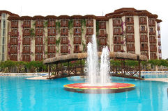 Swimming pool with fountain at the luxury hotel Stock Photos