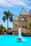Swimming pool with fountain at luxury hotel Stock Photo