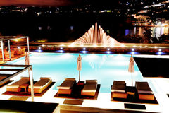 Swimming pool with fountain in night illumination Royalty Free Stock Images
