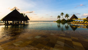 Swimming pool at Four Seasons Resort Maldives at Kuda Huraa Stock Photo