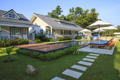 Swimming pool in front of bungalow Stock Images