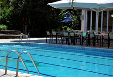 Swimming pool. In front of a luxury hotel Stock Images