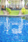 Swimming pool in front of rooms at the hotel Stock Images