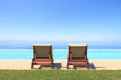 Swimming pool in front of the sea Royalty Free Stock Images