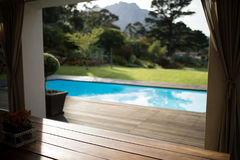 Swimming pool in the front yard of house. On a sunny day Royalty Free Stock Photos