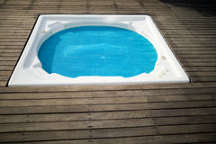 Swimming pool in the front yard of house. On a sunny day Royalty Free Stock Images