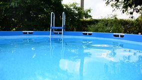 Swimming pool. Full of waving clear water in the garden stock video footage