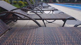 Swimming pool furniture. A row of empty lounger Royalty Free Stock Images