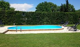 Swimming pool. In the garden Stock Images