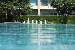 Swimming pool and garden. Swimming pool with fountain and garden Stock Images