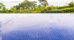 Swimming pool with garden and see view. In Thailand Stock Images