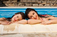Swimming pool girl friends royalty free stock image