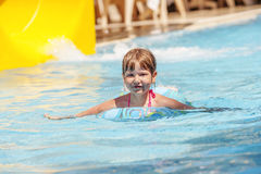Swimming in pool. Girl swimming in pool during Turkey vacations summer holiday Stock Photography