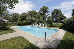 Swimming pool with golf course view Royalty Free Stock Photos