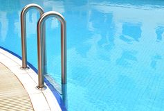 Swimming pool grab bars ladder Stock Images