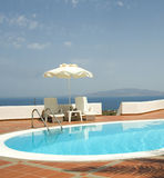 Swimming pool greek islands santorini Stock Photos
