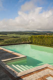 Swimming pool and green field,Tuscany,Italy. Nice view of a swimming pool on italian hills Royalty Free Stock Images