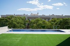 Swimming pool with the green grass Royalty Free Stock Image
