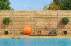 Swimming pool with gym equipment Stock Photography