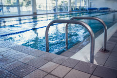 Swimming pool with hand rails Stock Photography