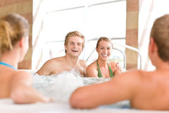 Swimming pool - happy couple relax in hot tub. Swimming pool - young happy couple relax in hot tub stock images