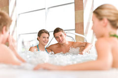 Swimming pool - happy couple relax in hot tub Royalty Free Stock Photography