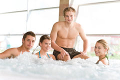 Swimming pool - happy people relax in hot tub Stock Images