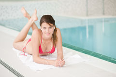 Swimming pool - happy woman relax listen to music. With ear buds Stock Photos