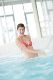 Swimming pool - happy woman under water stream Stock Photography